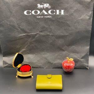 Coach Accordion Zip Wallet.